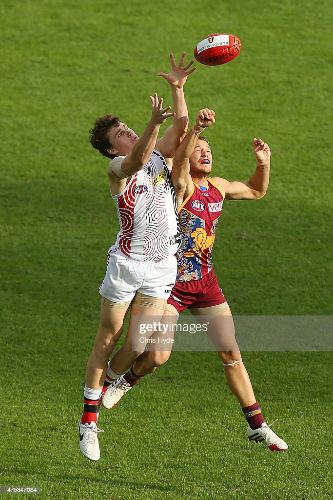 James Aish of the Lions spoils a mark from Blake Acres of the Saints during the round nine AFL match between the Brisbane Lions and the St Kilda Saints at The Gabba on May 31, 2015 in Brisbane, Australia.