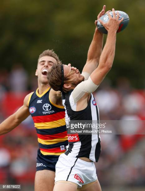 James Aish of the Magpies and Jordan Gallucci of the Crows compete for the ball during the AFLX match between the Adelaide Crows and the Collingwood...