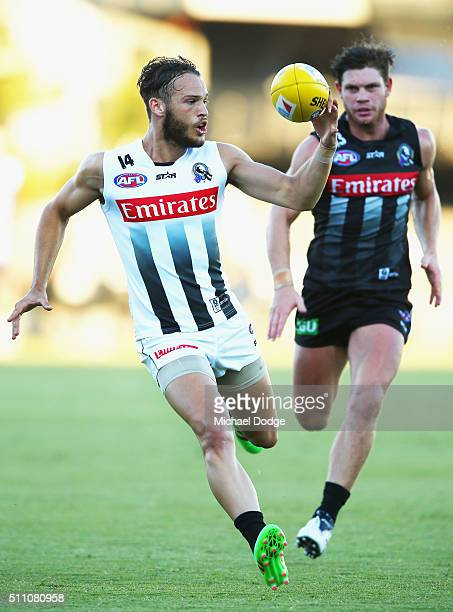 James Aish of the Magpies gathers the ball in front of Taylor Adams during the Collingwood Magpies AFL Intraclub match at Olympic Park on February 18...