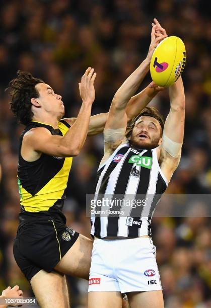 James Aish of the Magpies marks infront of Daniel Rioli of the Tigers during the AFL Preliminary Final match between the Richmond Tigers and the...