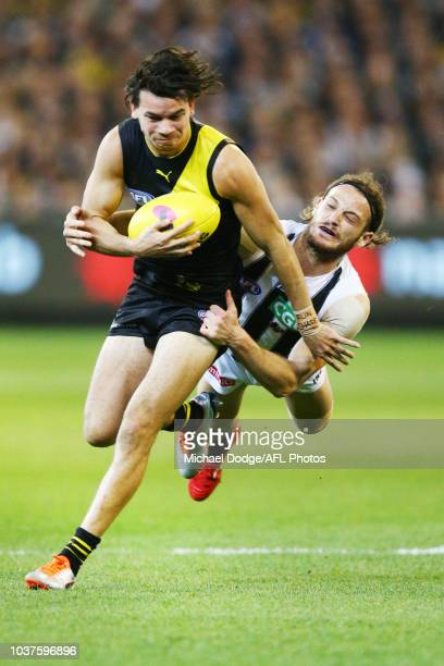 James Aish of the Magpies tackles Daniel Rioli of the Tigers during the AFL Preliminary Final match between the Richmond Tigers and the Collingwood...