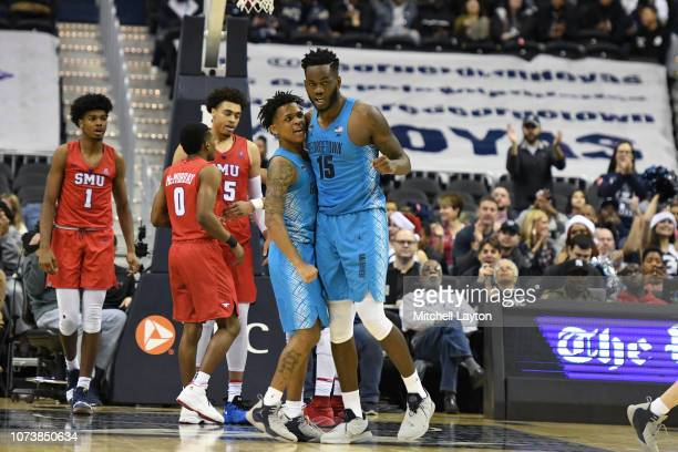 James Akinjo and Jessie Govan of the Georgetown Hoyas celebrates a shot during a college basketball game against the Southern Methodist Mustangs at...