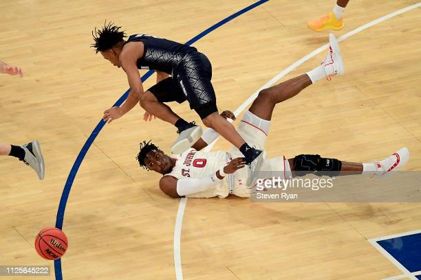 James Akinjo of the Georgetown Hoyas battles for the ball with Sedee Keita of the St John's Red Storm at Madison Square Garden on January 27 2019 in...