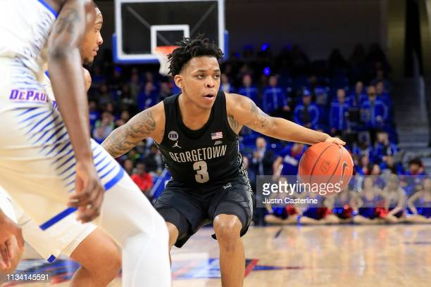 James Akinjo of the Georgetown Hoyas brings the ball up the court in the game against the DePaul Blue Demons during the first half at Wintrust Arena...