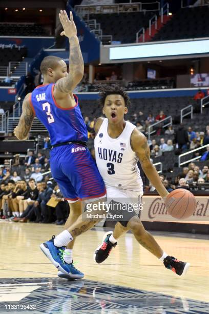 James Akinjo of the Georgetown Hoyas dribbles a round Devin Gage of the DePaul Blue Demons during a college basketball game at the Capital One Arena...