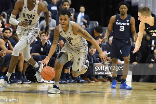 James Akinjo of the Georgetown Hoyas dribbles down court during a college basketball game against the Xavier Musketeers at the Capital One Arena on...