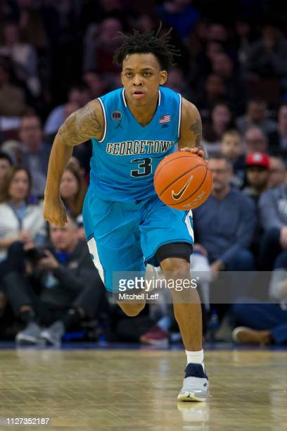 James Akinjo of the Georgetown Hoyas dribbles the ball against the Villanova Wildcats at the Wells Fargo Center on February 3 2019 in Philadelphia...