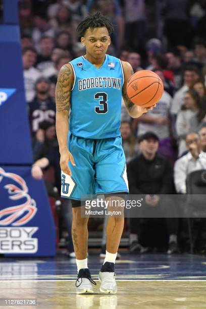 James Akinjo of the Georgetown Hoyas dribbles up court during a college basketball game against the Villanova Wildcats at the Wells Fargo Center on...