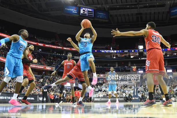 James Akinjo of the Georgetown Hoyas drives to the basket during a college basketball game against the St John's Red Storm at the Capital One Arena...