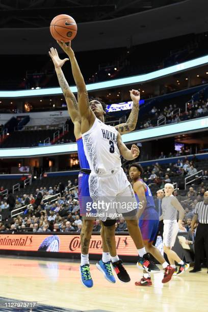 James Akinjo of the Georgetown Hoyas drives to the basket in the first half during a college basketball game against the DePaul Blue Demons at the...