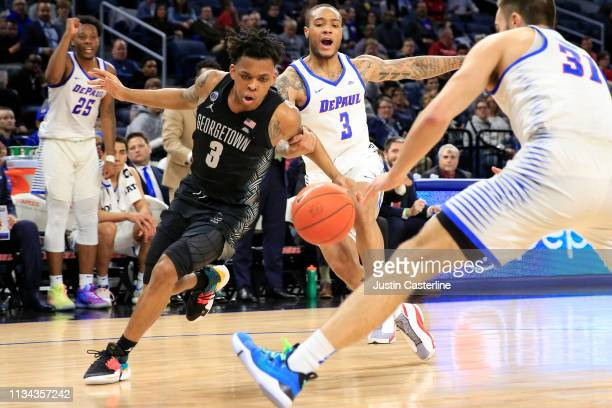 James Akinjo of the Georgetown Hoyas drives to the basket in the game against the DePaul Blue Demons during the first half at Wintrust Arena on March...