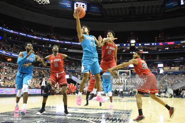 James Akinjo of the Georgetown Hoyas drives tot he basket during a college basketball game against the St John's Red Storm at Capital One Arena Arena...