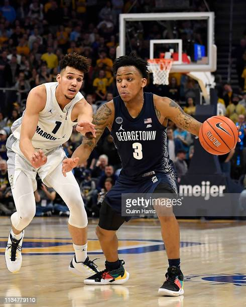 James Akinjo of the Georgetown Hoyas handles the ball in the second half against Brendan Bailey of the Marquette Golden Eagles at Fiserv Forum on...