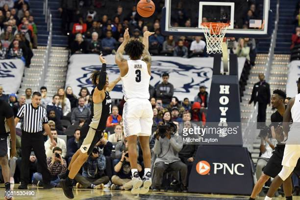 James Akinjo of the Georgetown Hoyas hits a three point shot to put game in to a second overtime during a college basketball game against the...