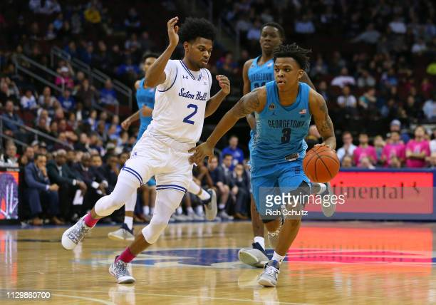 James Akinjo of the Georgetown Hoyas in action against Anthony Nelson of the Seton Hall Pirates during a game at Prudential Center on February 13...