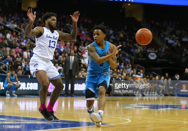 James Akinjo of the Georgetown Hoyas in action against Myles Powell of the Seton Hall Pirates during a game at Prudential Center on February 13 2019...