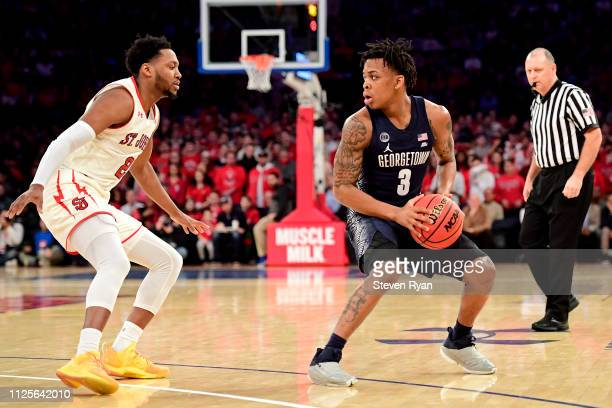 James Akinjo of the Georgetown Hoyas is defended by Shamorie Ponds of the St John's Red Storm at Madison Square Garden on January 27 2019 in New York...