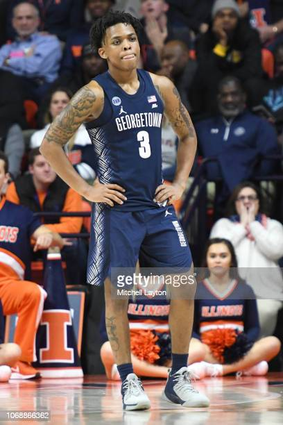 James Akinjo of the Georgetown Hoyas looks on during a college basketball game against the Illinois Fighting Illini at the State Farm Center on...
