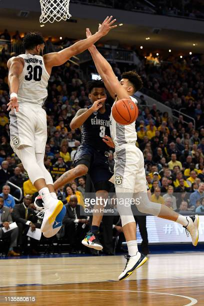 James Akinjo of the Georgetown Hoyas passes against Brendan Bailey of the Marquette Golden Eagles at Fiserv Forum on March 09 2019 in Milwaukee...