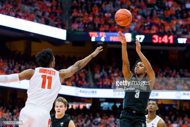 James Akinjo of the Georgetown Hoyas shoots the ball during the first half against the Syracuse Orange at the Carrier Dome on December 8 2018 in...