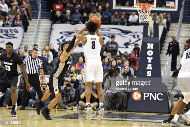 James Akinjo of the Georgetown Hoyas takes a jump shot during a college basketball game against the Providence Friars at the Capital One Arena on...