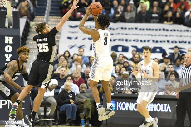 James Akinjo of the Georgetown Hoyas takes a jump shot over Drew Edwards of the Providence Friars during a college basketball game at the Capital One...