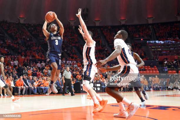 James Akinjo of the Georgetown Hoyas takes a shot during a college basketball game against the Illinois Fighting Illini at the State Farm Center on...