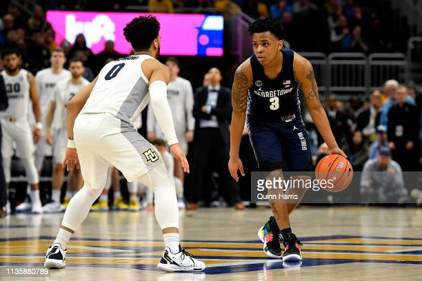 James Akinjo of the Georgetown Hoyas takes on Markus Howard of the Marquette Golden Eagles at Fiserv Forum on March 09 2019 in Milwaukee Wisconsin