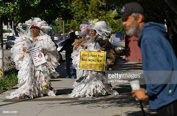 James Alamillo of Heal the Bay and Amada Griesbach also of Heal the Bay walks down Temple Street in downtown Los Angeles on November 16 2010 They had...