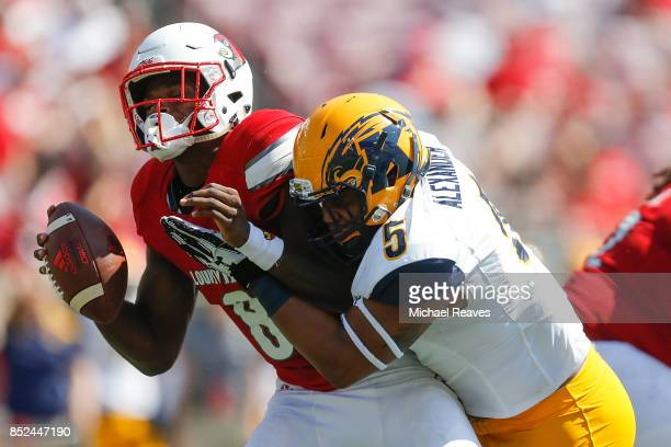 James Alexander of the Kent State Golden Flashes sacks Lamar Jackson of the Louisville Cardinals during the second half at Papa John's Cardinal...