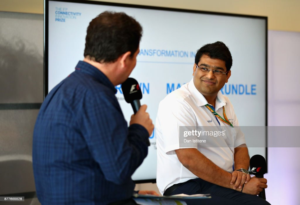 James Allen talks with Mehul Kapadia on stage during the F1 Connectivity Innovation prize giving at Yas Marina Circuit on November 23, 2017 in Abu Dhabi, United Arab Emirates.