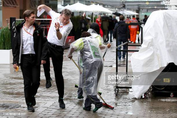 James Allison, Technical Director at Mercedes GP avoids a cleaner in the Paddock during practice for the F1 Grand Prix of Brazil at Autodromo Jose...