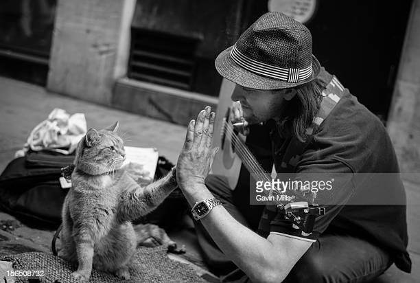 James and Bob just before their book was released busking in Covent Garden. A street Cat named Bob by James Bowen