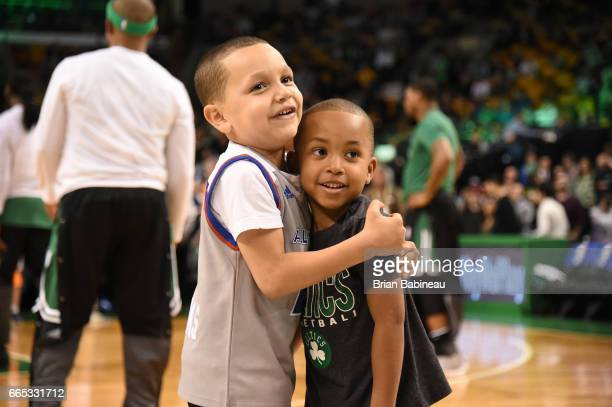 James and Jaiden sons of Isaiah Thomas of the Boston Celtics takes in the views prior to the game against the Cleveland Cavaliers on April 5 2017 at...