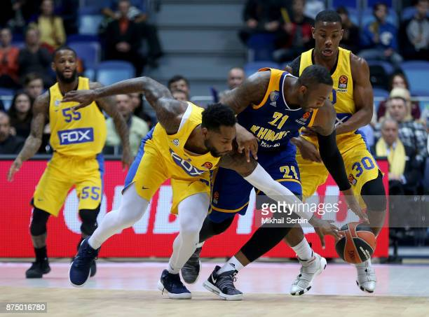 James Anderson #21 of Khimki Moscow Region competes with Jonah Bolden #43 and Norris Cole #30 of Maccabi Fox Tel Aviv in action during the 2017/2018...