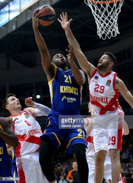 James Anderson #21 of Khimki Moscow Region competes with Patricio Garino #29 of Baskonia Vitoria Gasteiz in action during the 2017/2018 Turkish...
