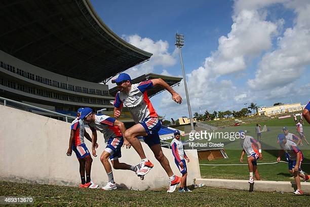 James Anderson and Adam Lyth during a hill shuttle sprint session during the England nets session at the Sir Vivian Richards Stadium on April 11 2015...