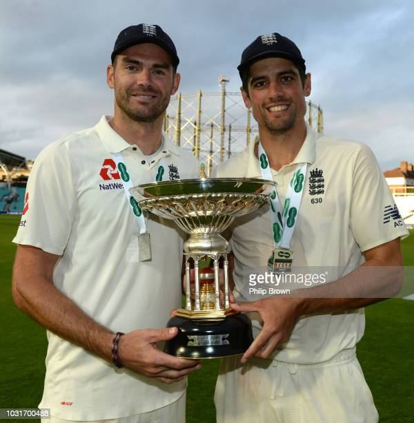 James Anderson and Alastair Cook of England with the trophy after England won the fifth Specsavers Test Match between England and India at The Kia...