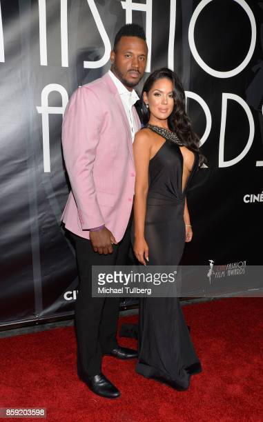 James Anderson and model Carissa Rosario attend the 4th Annual CineFashion Film Awards at El Capitan Theatre on October 8, 2017 in Los Angeles,...