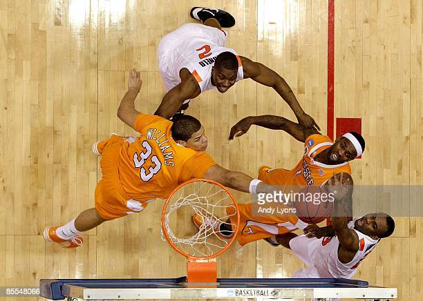 James Anderson and Obi Muonelo of the Oklahoma State Cowboys fight for a loose ball with Brian Williams and Tyler Smith of the Tennessee Volunteers...