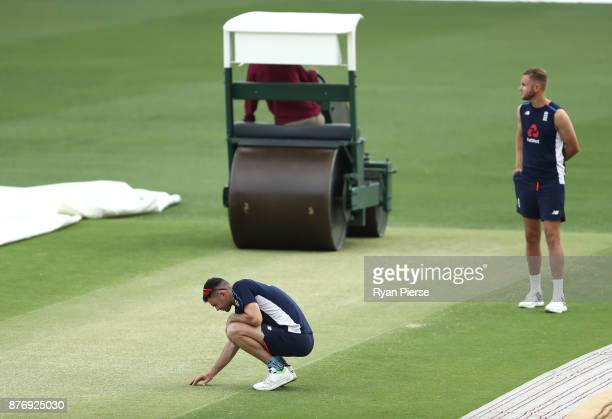James Anderson and Stuart Broad of England inspect the pitch during an England nets session at The Gabba on November 21 2017 in Brisbane Australia