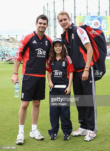 James Anderson and Stuart Broad of England poses for a picture with Brit Mascot Jasmine Jones during the 3rd Natwest One Day International match...