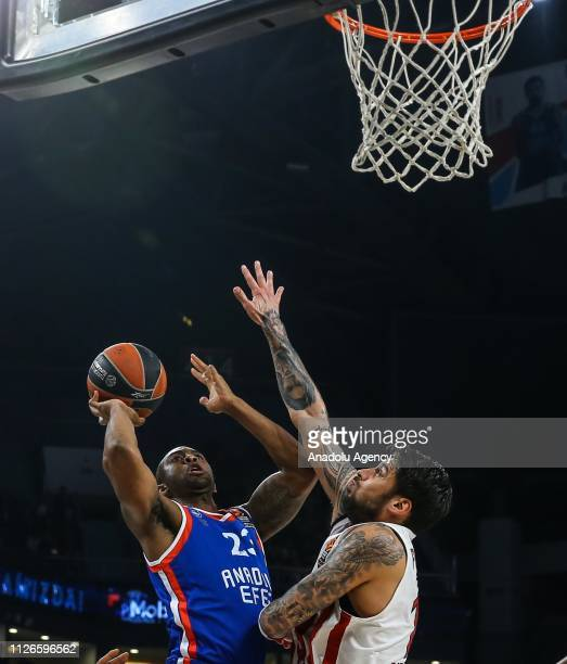 James Anderson of Anadolu Efes in action against Georgios Printezis of Olympiacos during Turkish Airlines Euroleague basketball match Week 23 between...
