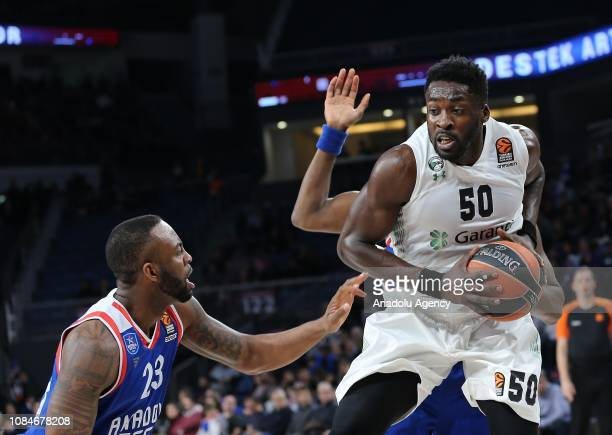 James Anderson of Anadolu Efes in action against Michael Eric of Darussafaka Tekfen during Turkish Airlines Euroleague basketball match between...