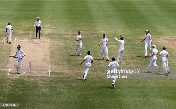 James Anderson of celebrates capturing the wicket of Marlon Samuels of West Indies to equal Ian Botham's record of 383 Test wickets during day five...