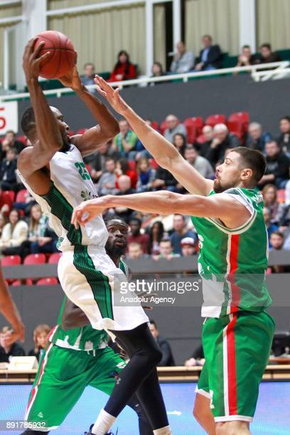 James Anderson of Darussafaka Dogus in action against Grigoriy Shukhovtsov of UNICS Kazan during the EuroCup basketball match between UNICS Kazan and...