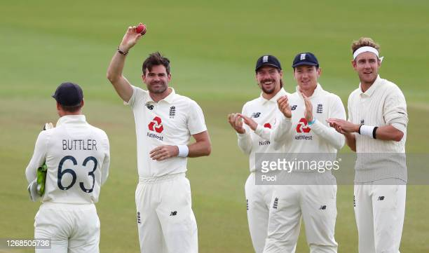 James Anderson of England acknowledges the changing rooms whilst being applauded by Rory Burns, James Bracey and Stuart Broad of England after taking...