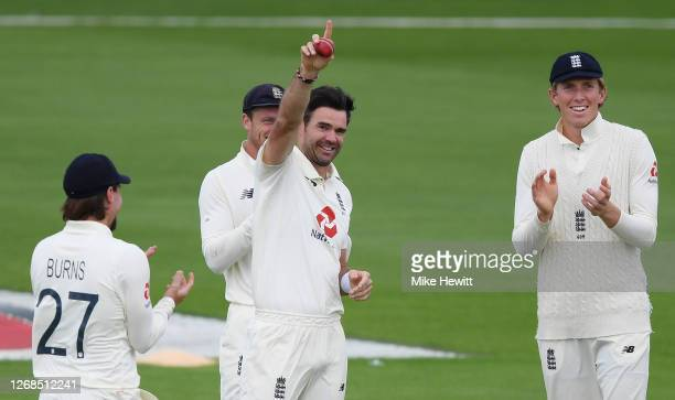 James Anderson of England acknowledges the changing rooms whilst being applauded by Zak Crawley, Jos Buttler and Rory Burns after taking the wicket...