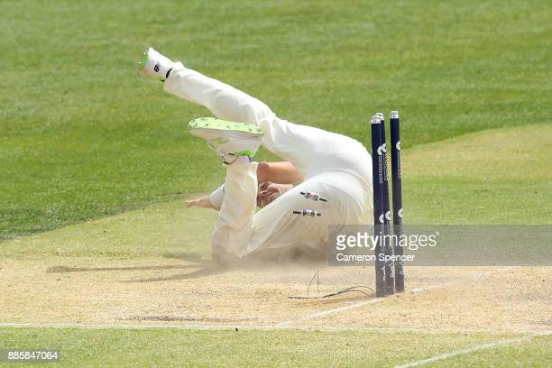James Anderson of England attempts to catch the ball off his own delivery during day four of the Second Test match during the 2017/18 Ashes Series...