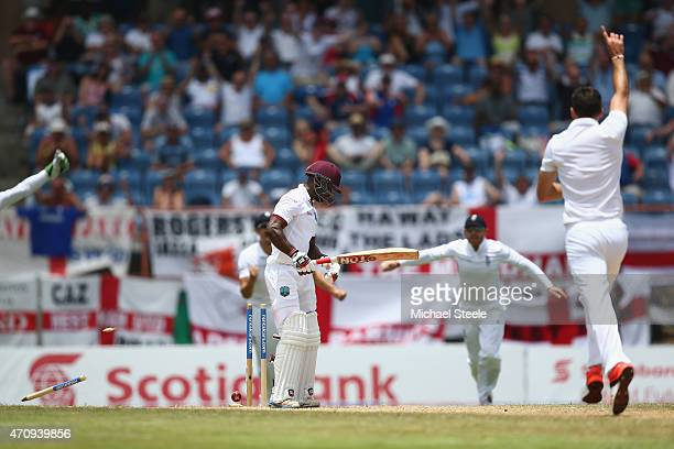 James Anderson of England bowls Devon Smith of West Indies during day four of the 2nd Test match between West Indies and England at the National...